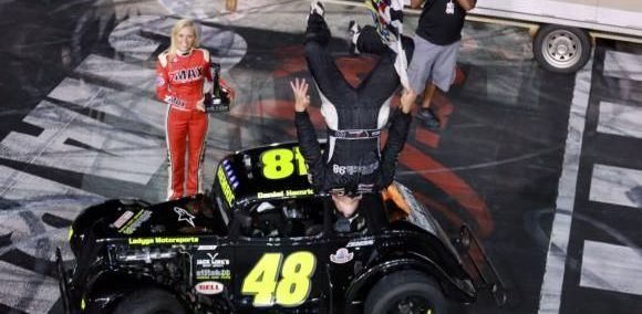 Daniel Hemric celebrates his third Jack in the Box Summer Shootout Series Legend Car Pro division championship with a backflip.